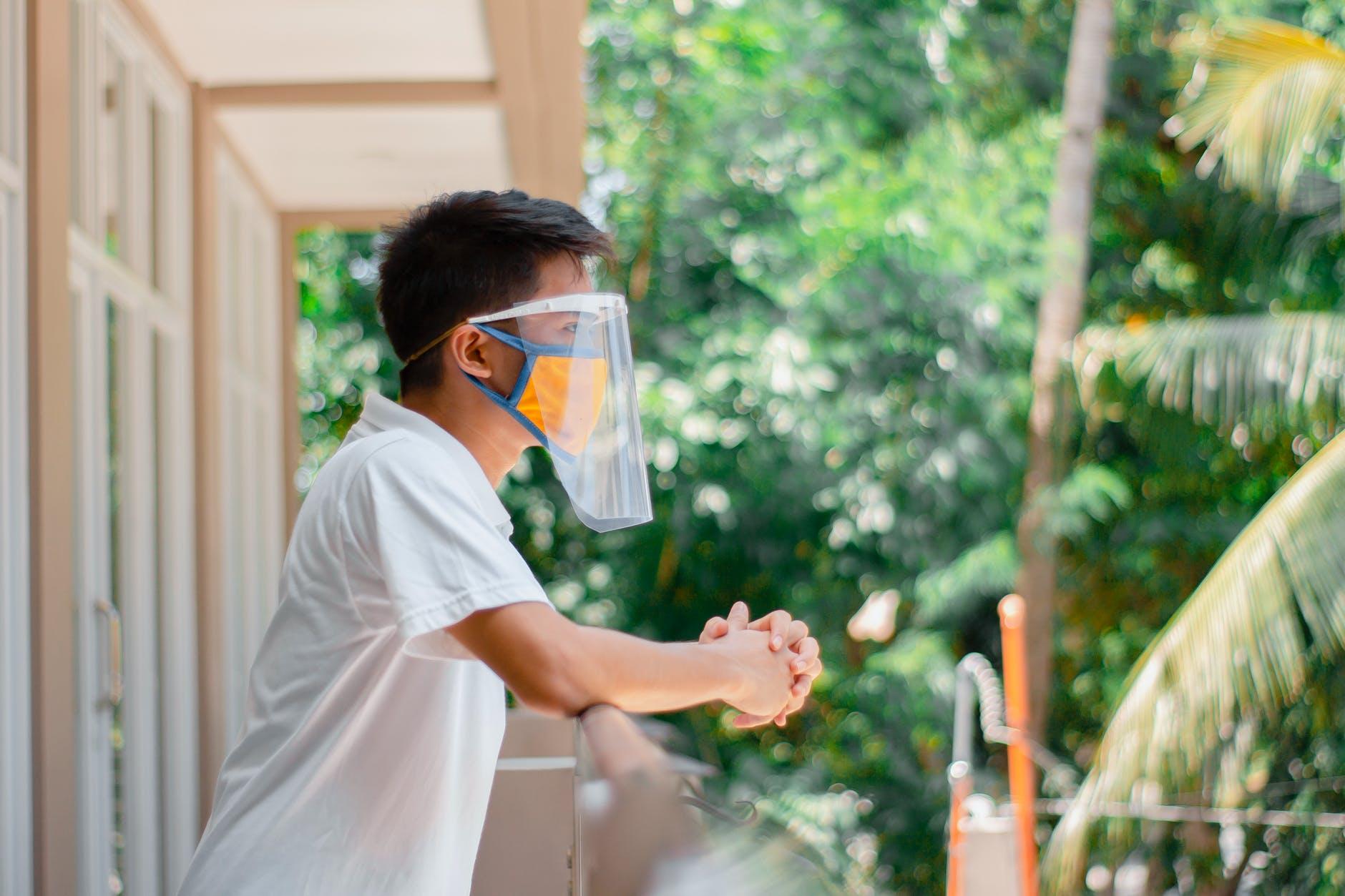 man in white t shirt wearing face mask