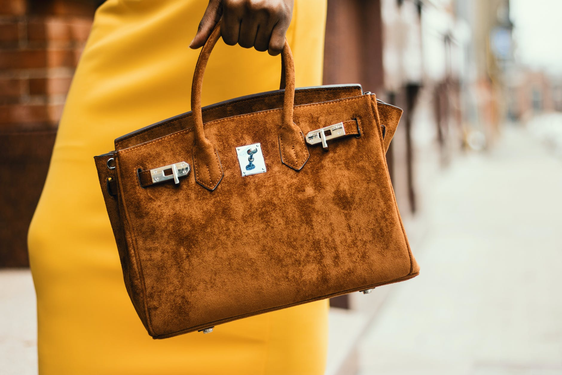 woman wearing brown leather tote bag