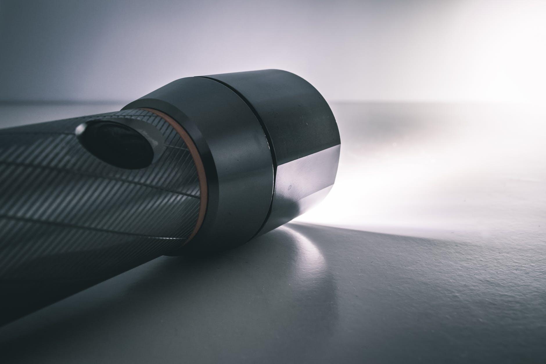 black flashlight turned on